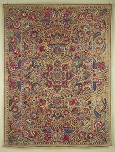West India, Gujarat, 18th century, Silk embroidery on cotton, 22 x25 cm / An 18th century coverlet from the Deccan with a vigorous floral design embroidered with spectacular colours. A similar example is now in a Portuguese museum confirming our suspicion that these embroideries were made for export to Europe.