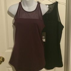 Scuba Mesh Active Tops- bundle of 2 Great active tanks in go-dry breathable fabric. Blackberry Jam and Black. Mesh panel in chest and full back. Lightweight fabric lets you vent. Fitted. These look great as dress tops too! Old Navy Active Tops Tank Tops