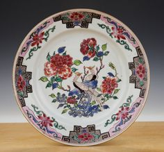Chinese export porcelain famille-rose plate decorated with two peacocks, peonies and other foliage. Qianlong, mid-18th century.