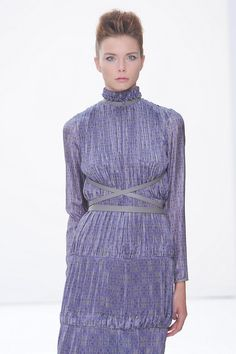 The@DAKSLondonshow was sublime, we adore this plissé maxi dress gathered at the waist and neck with a simple grey strap. #SS15 #LFW