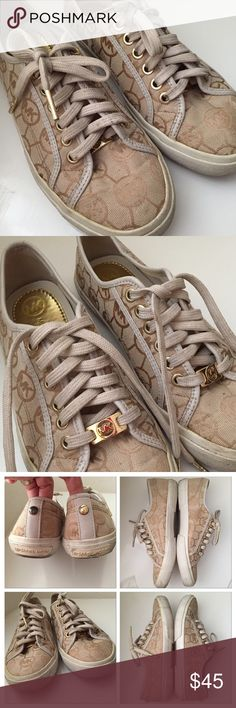 Michael Kors Beige Tan Sneakers Michael Kors cream/tan sneakers shoes. 6 size. Some wear and dirty as shown on photos. Just I don't have time to clean them. They were sitting in my closet. Very comfortable and stylish sneakers! Michael Kors Shoes Sneakers