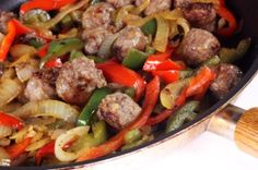 Italian Sausage and Peppers w/ touch of red gravy (One of DH's favorites to be served with warm crusty Tuscan loaf)
