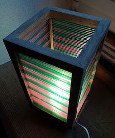 So cool. Basic Ikea desk lamp with a lampshade made from colored drinking straws.