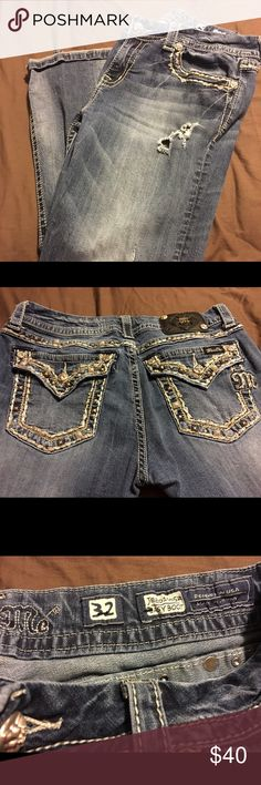 Women's Miss Me Jeans Size 32 Easy Boot Cut Women's Miss Me jeans size 32 Easy Boot Cut on the black Miss Me tag 2 of the buttons are missing but still a lot of wear in these super cute jeans. These are distressed and the holes came like that. Miss Me Jeans Boot Cut