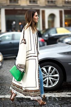Street style fall outfit: embroidered statement coat, jeans and heels
