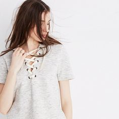 """Inspired by the Japanese concept of """"one-mile wear,"""" Mile(s) by Madewell is a collection for all the stuff you do close to home—the post-workout hangs, the neighborhood coffee strolls, the couch marathons. Made of soft fabrics in sleek shapes, it's your new weekend-starts-now uniform. Take this lace-up hoodie—it has short sleeves and a supersoft fleece lining perfect for those not-too-cold, not-too-hot days. <ul><li>True to size.</li><li>Cotton/..."""