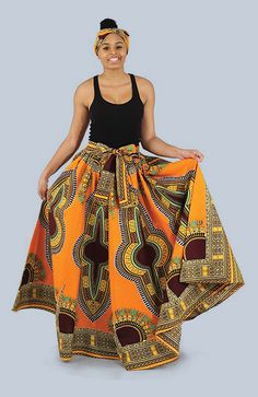 Traditional Print Maxi Skirt - Womens traditional print African skirt with bold African patterns and colors.  Celebrate Black History Month with this beautiful African style skirt.  It is perfect for travel since its both comfortable and dressy enough to wear out to dinner or a special event.  Each skirt is decorated with bold African patterns and comes in a wide variety of colors.  #fashion #africa #african #pattern #style #africanfashion #womensfashion #africanamerican #blackhistorymonth…