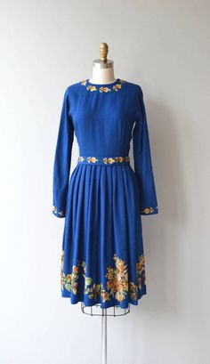 Vintage 1950s cobalt blue wool dress with exquisite floral embroidery at the neckline, sleeves, belt and hem. Fitted waist with metal zipper at the back of the neck and side of the waist. --- M E A S U R E M E N T S ---  fits like: extra small/small bust: 35 waist: 2526 hip: free length: 41 brand/maker: n/a condition: excellent  to ensure a good fit, please read the sizing guide: http://www.etsy.com/shop/DearGolden/policy  ✩ layaway is available for thi...