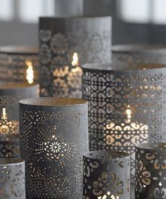 DIY | Punched Paper Candles {tutorial}: Purchase pre-punched paper from a craft store such as Michael's and wrap the paper around the candle holder.