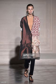 A model walks the runway during the Maison Martin Margiela show as part of the Paris Fashion Week Womenswear Spring/Summer 2015 on September 26, 2014 in Paris, France.