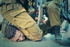 Brave Israeli soldiers arresting a child.