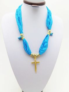Turquoise silk gold metal cross necklaceOOAK by Themagicofcolors, $32.99