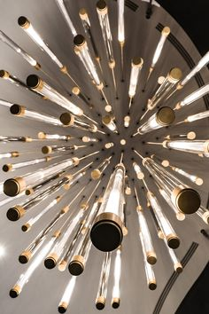 A sculptural lighting installation composed of 75 bespoke illuminated pendants, hung over a stunning spiral staircase linking both floors of the main atrium at Foster + Partners Prinicipal Tower development. A constant stream of cascading light falls within glass tubes, suggestive of a flow of data or a light rainfall, and symbolic of the bustling London business district outside.⠀  #lightbyhaberdashery #lightinstallation #luxurylighting #modernchandelier #chandelierlighting… Modern Chandelier, Chandelier Lighting, Cascade Lights, Ceiling Fan, Ceiling Lights, Foster Partners, Luxury Lighting, Spiral Staircase, Hanging Pendants