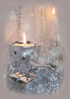 A silver holiday vignette!!! Bebe'!!! Lovelybsilvsr candle, beading and silver foil wrapped presents!!!