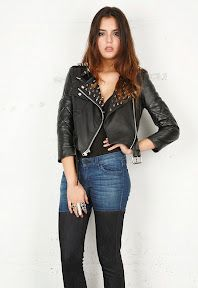 Edgy and chic, this cropped leather jacket features pyramid studs at  lapels, fold-over collar, and epaulet detail at shoulders.