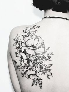 Intricate back flower tattoo. Click to discover more Sensational Flower Tattoos.