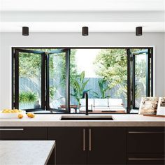 Bi-fold windows are perfect for a servery. A simple way to bring a café-like feel to your living areas. window : Bi-fold windows are perfect for a servery. A simple way to bring a café-like feel to your living areas. Home Decor Kitchen, House Design, House, Kitchen Window, Windows, Home Remodeling, New Homes, Home Renovation, Kitchen Window Design