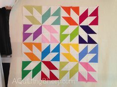 A Quilting Sheep: Wake Up to Kona Solids!! Half Square Triangle quilt blocks in a colorful, geometric design