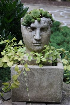 The Artful Garden. ... Sam likes sculptural details like this for garden decor. We found some truly ginormous head/face pots at our local nursery that were awesome... and expen$ive... Someday, though! Someday!