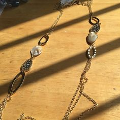 Gold tone long e chain necklace Gold tone chain with hematite crystals n free-form seashell nuggets Park Lane Jewelry Necklaces