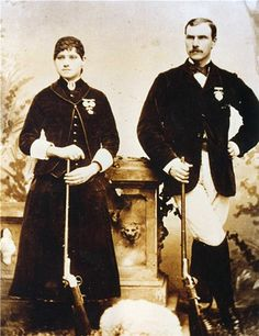 Phoebe Ann Mosey a.k.a. Annie Oakley (L) (1860-1926), and her husband Francis E. Butler a.k.a. Frank Butler (R) (1847-1926).  Annie was an American sharpshooter and exhibition shooter. Frank was an Irish American marksman. Both performed in Wild West variety shows.
