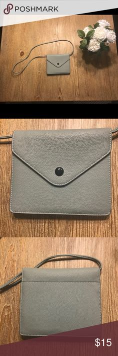 Urban Outfitters cross body wallet-purse Urban Outfitters cross body wallet-purse. Excellent condition. Used once. Teal blue color Urban Outfitters Bags Clutches & Wristlets