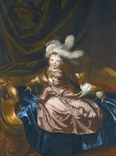 JACOB VAN LOO SLUIS 1614 - 1670 PARIS PORTRAIT OF A BOY, FULL LENGTH, IN PINK SILK PLAYING WITH TWO PUPPIES oil on canvas, in an 18th-century carved and gilt frame 153 by 115.5 cm.; 60 1/4  by 45 1/2  in.