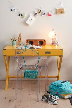 Add a splash of color to your workspace in unexpected ways like this butterscotch yellow writing desk. Featured product includes: Baxton Studios armed ghost chair, HomeVance writing desk, Simple by Design clip string lights, and JanSport aqua backpack. Get set to head back to school with Kohl's.