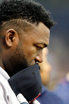 David Ortiz of the Boston Red Sox pauses during a moment of silence for MIami Marlins pitcher Jose Fernandez before the start of their game against...