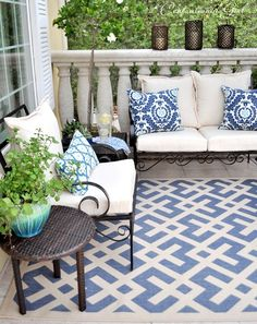 love the rug and pillows on this  beautiful balcony