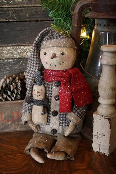 Prim Snowman Doll--- Put a green scarf on this cutie and he'd fit in my home...