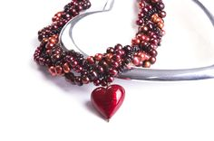 big vivid valentine scarlet murano heart necklace with pearls and garnet from Bish Bosh Becca £74