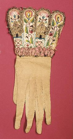 Glove with embroidered cuff.