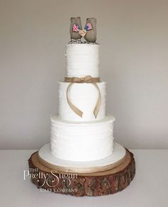 Rustic style icing wedding cake with love birds topper