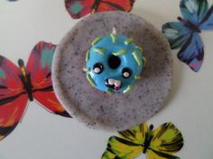 Polymer clay Silly Face Neon Donut charm by solarstarcharms https://www.etsy.com/listing/234958516/polymer-clay-silly-face-neon-donut-charm?ref=shop_home_active_12