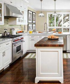 open kitchen remodel after with butcher block top island, range, range hood, tile backsplash