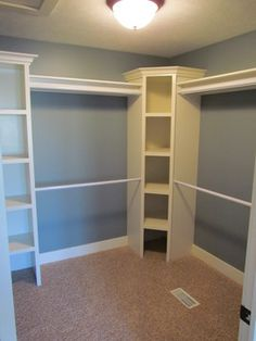 Great use of those awkward corners in the walk in closet. Double hanging rods for hanging clothes. Master walk-in closet with shelves shelving storage organization. Closet Redo, Closet Remodel, Master Bedroom Closet, Closet Storage, Bathroom Closet, Walk In Closet Organization Ideas, Diy Closet Ideas, Closet Space, Master Bathroom