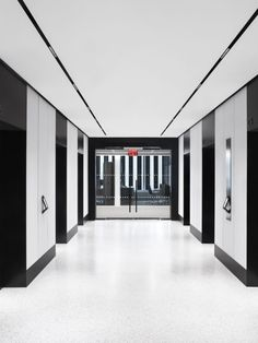 Our minimalist MAGNETO track system is fully customizable with linear, spot, and distribution options. It's pictured here in a black and white themed elevator lobby. Lobby Interior, Interior Lighting, Luxury Interior, Wall Lighting, Modern Interior, Interior Design, Mix Use Building, Building Signs, Studios Architecture