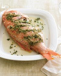 1 whole red snapper, cleaned, slashed and stuffed with paste of salt, cilantro, ginger, garlic, scallions and sesame oil. Rub with canola oil and salt, bake upright at 425 for 30 min. Perfect.