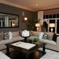 Love the dark wood and light fabric combos.