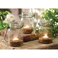 Combining the warmth of candlelight with a touch of natural sand, this candle set offers a soft ambiance to tables, shelves and patios in any home or office.