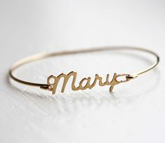 Name Bracelets by Diament Designs  @ Uncovet  //  Awesome vintage name bracelet from the 50s or 60s.