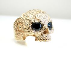 Solid gold 10k onyx eyes skull ring handmade in Canada samcro sons of anarchy. $1,575 via Etsy.
