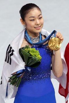 South Korea's Yuna Kim becomes that nation's first-ever Women's Olympic Figure Skating Champion.    Source: BlazingBlades.com PhotoLog