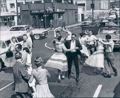 Dancing in the street in the 1950s - source Another Vintage Point.