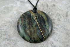 Kintsugi (kintsukuroi) inspired brown crazy lace agate round pendant with gold repair on black cotton cord - OOAK by AKintsugiLife