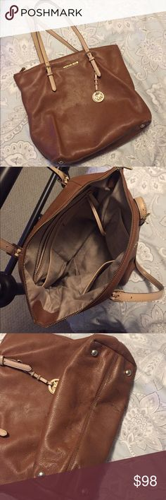 Michael Kors Shoulder Bag Authentic and Beautiful soft chestnut leather by Michael Kors! Lots of compartments inside, attached key holder; gently used. Bottom shows some signs of wear but not noticeable till you look on the bottom. Michael Kors Bags Shoulder Bags