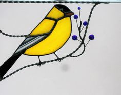 Size: approximately 6 1/2 x 6 HxW. Position: bottom left corner. We offer color options for the berries.  Birds are joyful creatures. Whether you watch them in the wild, at a bird feeder or see them in your window as a lovely corner design, they are colorful and cheery. I have two windows full of bird and vine corners in my work room and the light glowing through the colors is warm and inviting and just makes me feel good.  Maybe you or someone you know would enjoy the charm our birds br...