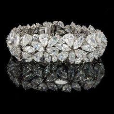 Best Diamond Bracelets : HARRY WINSTON, New York, Marquise, pear & round diamond Abstract bracelet. Diamond Bracelets, Diamond Jewelry, Bangle Bracelets, Bracelet Set, Bangles, Wedding Bracelet, Flower Bracelet, Diamond Rings, Jewelry Box