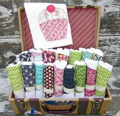 craft show display ideas aprons   suitcase display for burp cloths, bibs and/or kitchen towels